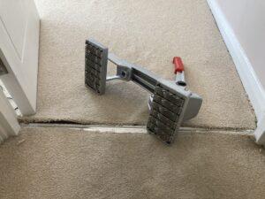 Edging carpet stretch in progress (A)