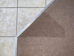 Carpet transition damage after
